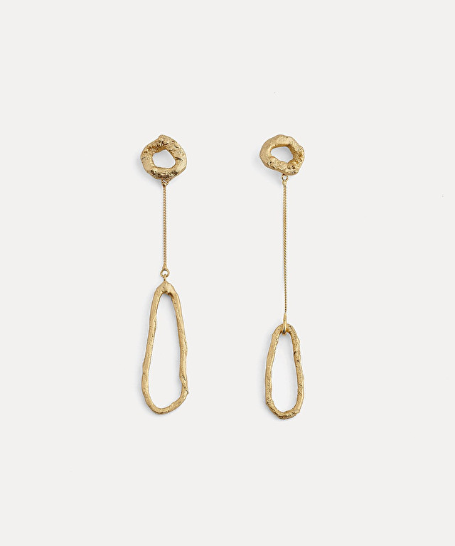 sculptural earrings with asymmetric pendant detail