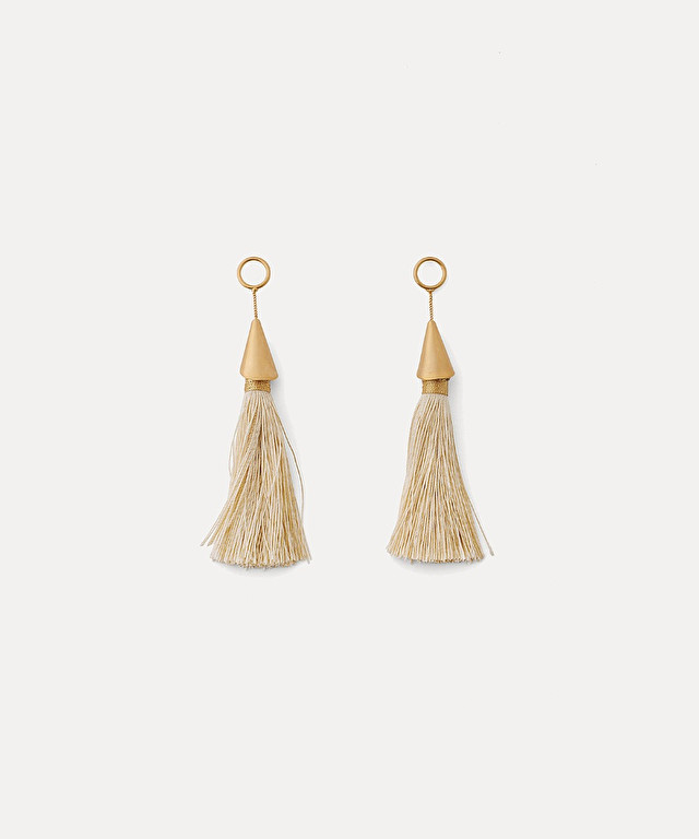 dangling earrings with tassel embellishment